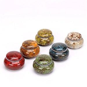 Tanque de sello de cerámica Mini Pequeño horno de cerámica Tarro de porcelana Sellado de polvo líquido Cajas de embalaje cosmético Tanques de sello líquido de pote de miel
