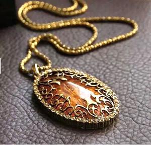 Collana a lunga catena dei monili della collana di ambra dell'annata Hollow Maglione