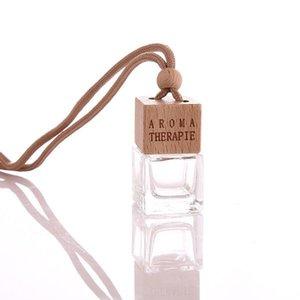 100pcs / lot de la botella vacía de vidrio esmerilado Claro Aroma Colgando aceite esencial de aromaterapia de cristal botellas de perfume del coche de la botella 5ml