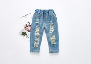Bebés niños niñas Jeans 2018 Nueva Moda niños Niños Denim Jeans niñas Pantalones Bebé Agujeros pantalones niños pantimedias pantalones largos