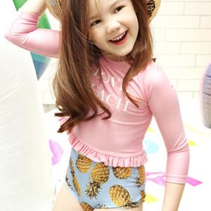 Baby Girl Two Pieces Chlidren traje de baño de manga larga para tomar el sol 2018 separa traje de baño de estampado de piña de cintura alta