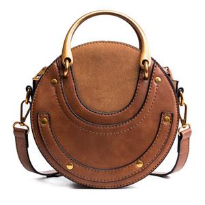 2018 New Fashion Metal Ring Handbag One Shoulder Cross-body Bag Small Round Package Retro Women Mini Circle Bag