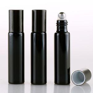 Bottiglie di profumo riutilizzabili di vetro vuoto UV dell'oro nero di 10ML con le sfere cosmetiche del rullo dell'olio del metallo