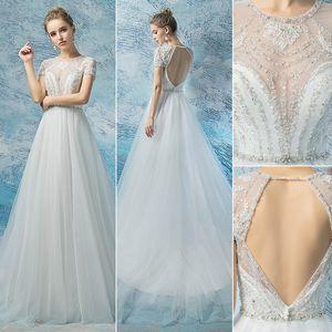 Luxury Beach Boho Wedding Dresses Short Sleeves Cheap tulle Long Bridal Gowns open back beading Backless robe de mariee Sheer Neck