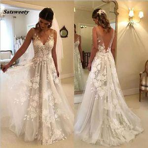 Playa Vestido De Noiva 2019 Vestidos de novia Una línea de cuello en V de encaje de tul sin espalda Dubai Árabe Boho vestido de novia Vestidos de novia