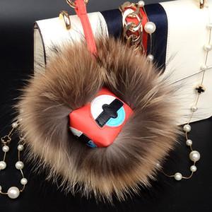 18 cm moelleux véritable fourrure pom poms bug petit monstre sac charme véritable pompon balle porte-clés luxe voiture bijoux pendentif porte-clés