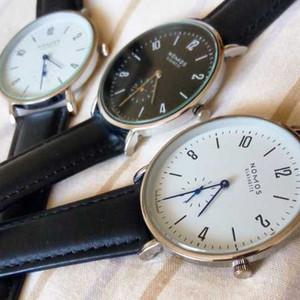 hombres y mujeres simples mujeres de moda de cuero de diseño minimalista correa de cuarzo relojes resistentes al agua NOMOS Relojes