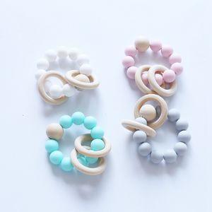 12pcs bébé anneaux de dentition silicone de qualité alimentaire et bois de hêtre anneau de dentition Bracelet dents de silicone mâcher jouets douche cadeaux BPA GRATUIT YE020