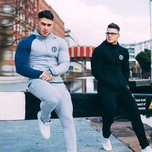 Pamuk erkek Setleri 2018 Moda Spor Eşofman Setleri erkek Hoodies + Pantolon Rahat Patchwork Dış Giyim Suits Artı Boyutu 3XL
