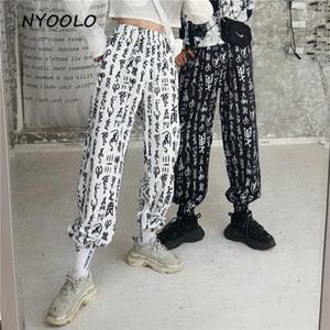 Sarouel décontracté style streetwear NYOOLO style Harajuku Printemps Automne lettres imprimé pantalon taille élastique cheville longueur femmes / hommes C18111301