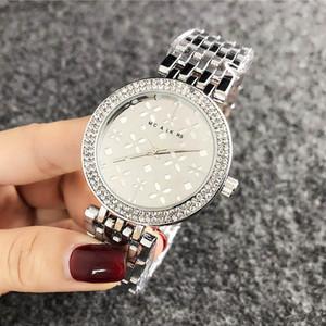 Marca di modo orologi da polso per la ragazza delle donne di stile del fiore della fascia d'acciaio di metallo orologio al quarzo M58