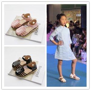 2018 summer new girls hollowed out comfortable and comfortable Baotou sandals beach sandals big boy Korean version