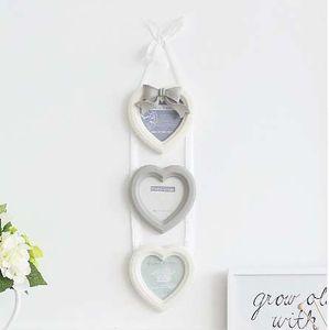 European Bow Gesamtbilderrahmen Wand Heart-shaped 4 Zoll 3-Zoll-Bilder-Rahmen-Kombinations-Wand montierte Bilderrahmen Dekoration 14X63CM
