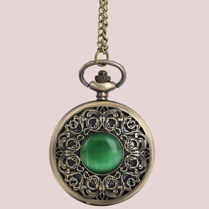 Large bronze vintage pocket watch creative center a bit of emerald cat eye carved hollow pocket watch 8063