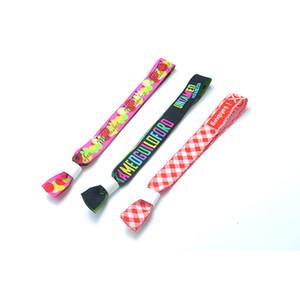 Il tessuto del nastro dei braccialetti del tessuto di sublimazione stampato abitudine cinga i braccialetti del poliestere gli eventi regolabili di festival del partito Braccialetti del polso