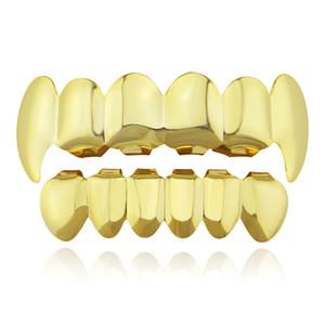 Hiphop grillz معدن الأسنان جريلز الذهب مطلي هالوين زخرفة الأسنان الأسنان جريلز أعلى أسفل الأسنان قبعات الجسم مجوهرات للنساء الرجال 2018