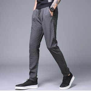 Pantaloni della matita da uomo Pantaloni di lino lino con coulisse Pantaloni della tuta da ginnastica elastica casual Pantaloni sportivi di cotone solido da uomo con tasche della schiena