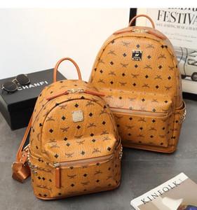 Мода женщины школьные сумки горячие панк стиль мужчины рюкзак заклепки дизайнер рюкзак искусственная кожа Леди сумки