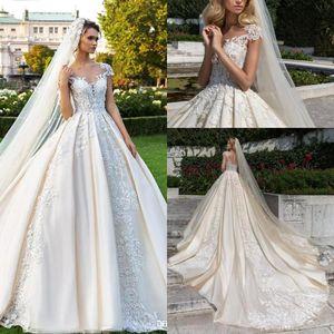 Elegantes vestidos de novia de encaje con mangas de Champagne 2018 Vestidos de novia de largo con una línea de satén Vestidos de novia cubiertos de ilusión