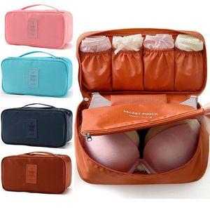 2018 Bolsa de cosméticos Mujeres Almacenamiento de viaje Cajas de ropa interior para lavar Sujetadores Organizador Bolsa de maquillaje Bolsa de viaje Necesidad Accesorios de viaje