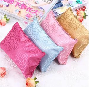 Neue kleine Buchstaben-Kosmetik-Beutel-weiblicher koreanischer Verfassungs-Beutel-Spielraum-notwendiges Speicher-Paket-populäre fördernde Geschenke
