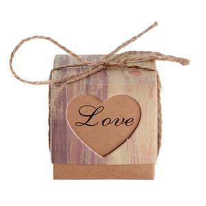 Suministros para la fiesta 50 unids Vintage grano de madera en forma de corazón hueco caja de dulces caja de regalo de papel favor de Kraft boda de la decoración