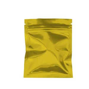 100 unids / lote Resellable 7.5 * 10 cm Oro Mylar Foil Embalaje Bolsa Sellado al calor Aluminio Zip Lock Bolsas de calidad alimentaria Embalaje Grip Seal Almacenamiento Bolsa