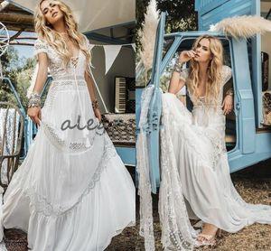 Vestidos de novia de encaje de ganchillo bohemio vintage Inbal Raviv Manga corta Con cuello en v que fluye llamarada Vacaciones de verano Vestido de novia