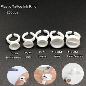 Heißer 200pcs Plastik-Tätowierungs-Tinten-Ring für Augenbrauen-dauerhafte Verfassung alle Größen weiße Tätowierungs-Pigment-Tinten-Halter-Ring-Behälter / Schale