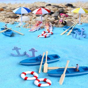 Una variedad de musgo Recoger Micro Paisaje Ornamento Pulpa Barco en la sombrilla de playa Silla de playa Lansha