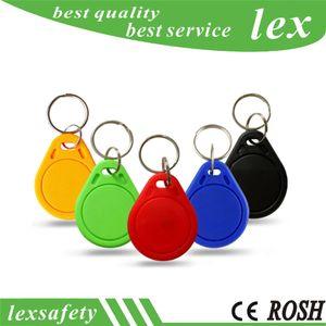 Mais baratos preços de fábrica de alta qualidade EM4100 100pcs 125kHz / lote ISO11785 ABS RFID personalizado plástico ID chaveiros etiquetas