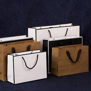 3 colores bolsa de papel kraft bolsa grande de papel de regalo de vacaciones de ropa trompeta medio con mango XD22306 libre del envío