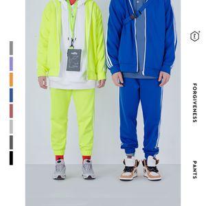 Pantalones deportivos unisex Guo Chao Hip-hop Hiphop Stripe Splicing Motion Paquete de pies Pantalones Ins Exceed Fire