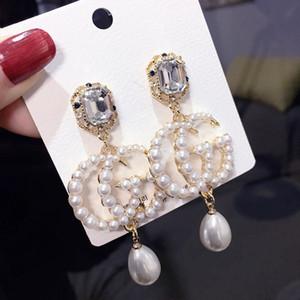venta al por mayor !!! mujeres S925 plata larga sección G letra pendiente de perlas
