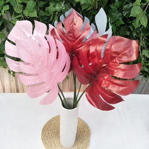 Colores artificiales tropicales hojas de palma falsa hojas de plástico Monstera flores decorativas para el camino que conduce de la boda Las plantas artificiales para el hogar