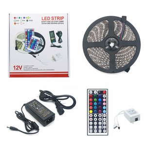 5M RGB LED Strip 60LEDs 5050 LED Light Christmas Gift impermeabile con 44 tasti IR Remote Controller + DC12V 5A Power Adapter in scatola al minuto