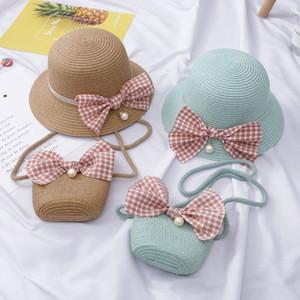 Niños del verano nuevos del arco Sombreros + bolso 2 PC sets sombrero y bolsas de paja niñas Hierba Protección trenza sombrero para el sol del verano del bebé sombrero de la playa de los niños
