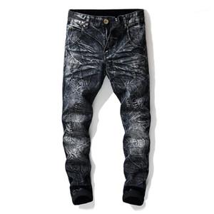 Lavato jeans strappati Street Style Mens pantaloni della matita nuovissimo progettista del Mens Jeans Moda blu e nero