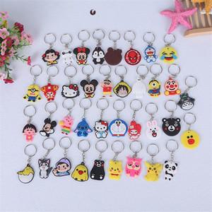 Cadeia 100pcs / Lot PVC Key desenhos animados titular chaveiro Crianças Anime Figura Keychain Key Kid Toy Pingente Trinket Chaveiros Mix Estilo Aleatoriamente