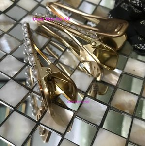8X2CM Fashion C sytel sone&Pearl hair clips with white card gold hair pin with fashion laser symbol classic hair accessories party gift