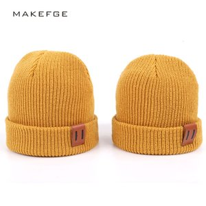 Adult children's knitted wool pullover hat leather label Pure Color warm baby's knitted hat all-match parent-child fashion