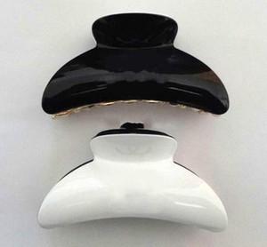 Nuevos productos de Europa y América en blanco y negro materiales tridimensionales pelo del retén CC acrílico accesorios de gran tamaño clip de la garra del pelo de la cabeza