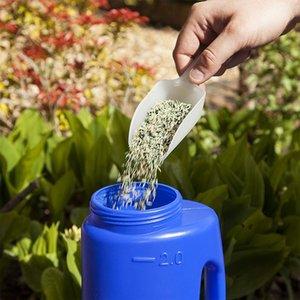 Realizada repelente de insetos Grama Planta de jardinagem Handle mão Semeador vegetais Fertilizantes furo ajustável Tamanho Seeds Espalhador PE Lawn