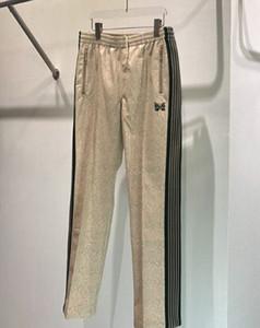 Erkek Tasarımcı Pantolon Pantolon İğneler Spor Rahat Yılan Derisi Desen Kelebek Nakış Dokuma Eşofman Altları Moda Marka Sweatpants