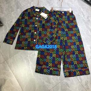 femmes haut de gamme filles pyjama de soie chemise mettre en tête imprimé lettre psychédélique blouse manches longues jogging pantalon large jambe Legging 2020 costume de mode