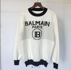 22999 automne et l'hiver Nouveau Chao Marque de mode couleur Lettre Coloring o-col à manches longues manches chandails tricotés avec Bas7 Blanc Laine