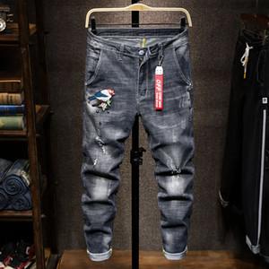 jeans firmati marea mens marca dei jeans rotti pantaloni a cavallo della tigre ricamato cranio distintivo uomini auto-coltivazione denim stretch pantaloni y857