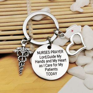 Porte-clés Charm Pendentif Coeur Keychain infirmière médicale Logo infirmière Cap Gravez Mots INFIRMIÈRES PRIÈRE Seigneur Keychain en acier inoxydable Cadeaux Bijoux