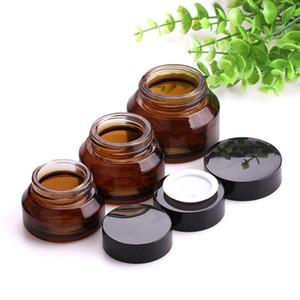 Vuoto Ambra contenitori di vetro 15g 30g 50g Bruni Glass Face Cream Jar riutilizzabili Contenitori trucco cosmetico Lozione in azione