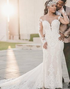 Plus Size Arabic Aso Ebi Backless Lace Mermaid Wedding Dresses Sheer Neck Long Sleeves Bridal Dresses Cheap Vintage Wedding Gowns Designer